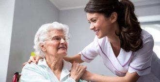 bigstock-Smiling-Nurse-And-Old-Woman-Pa-225849046_
