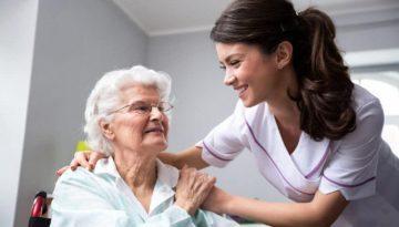 bigstock-Smiling-Nurse-And-Old-Woman-Pa-225849046_
