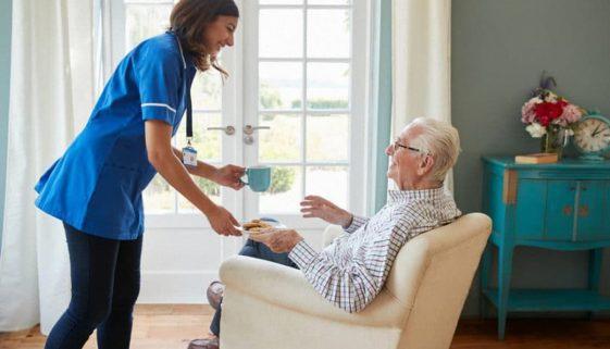 bigstock-Nurse-serving-a-cup-of-tea-to-206164369_